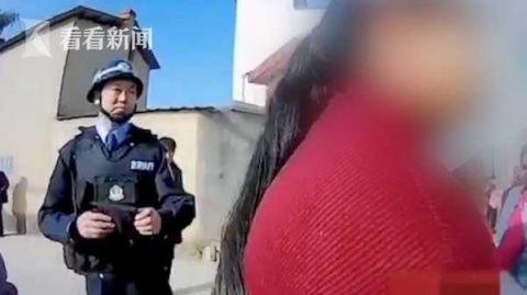 「北青网」一家老少阻碍执法 女子竟举起孩子砸向干警